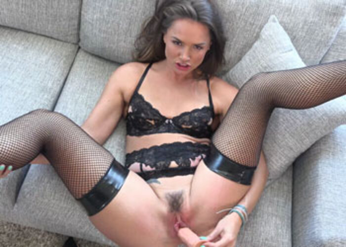 Tori Black's in fishnets and fucking a dong